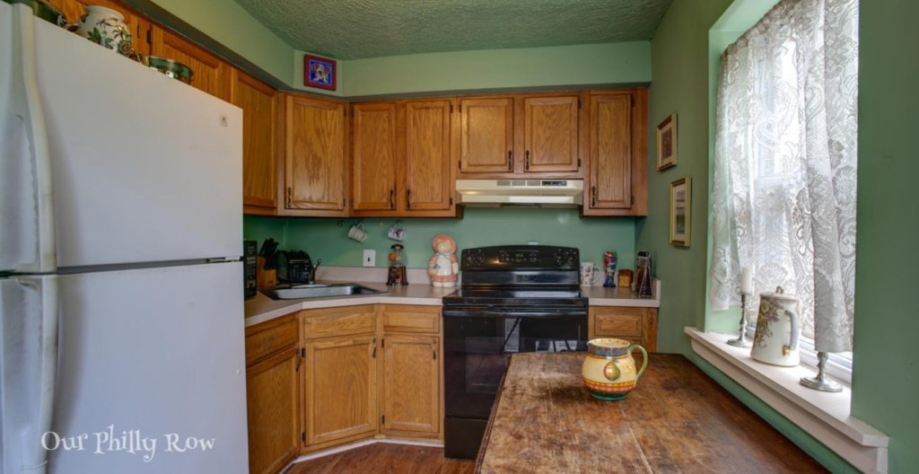 This is the result of a Big-box store vomiting a kitchen in the 90s. The green is a more recent change which is actually nicer than the pinkish tan it covered. Pretty? Ugh! (Image: Real Estate Listing)