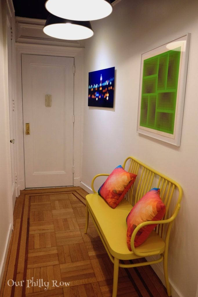 Another shot of our entry hall. The yellow bench was an early purchase and makes a great place to sit and take your shoes off.