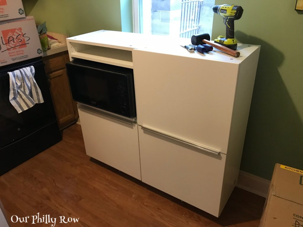 This was our fauxdenza in the entry gallery of our New York apartment. With the purchase of one more unit, it has been reconfigured and repurposed as a kitchen storage/microwave cabinet.